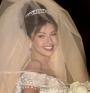 Mitzy ha tocado los cuerpos de estas famosas: El vestido de novia de Thalia(Univision)